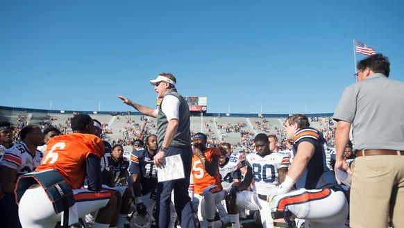 Auburn head coach Gus Malzahn speaks to his team during