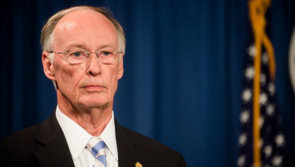 Gov. Robert Bentley stands during a press conference