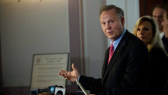 Suspended Chief Justice Roy Moore speaks during a press