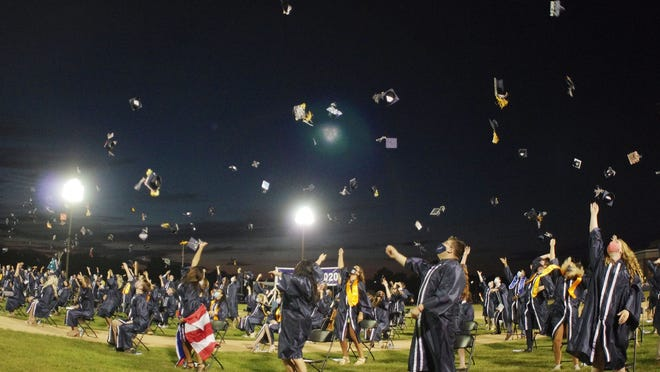 Rockland High School graduates toss their caps into after the ceremony.