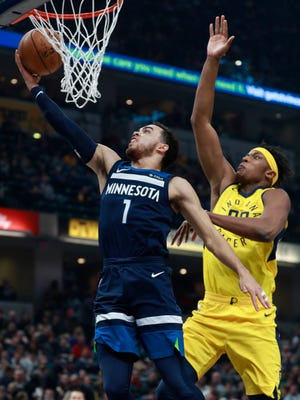 Minnesota Timberwolves guard Tyus Jones (1) shoots the basketball defended by Indiana Pacers center Myles Turner in the first half of an NBA basketball game, Sunday, Dec. 31, 2017, in Indianapolis.