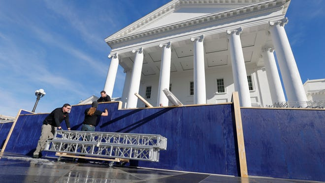 Workers move equipment used to construct the inaugural stand for the inauguration of Gov.-elect, Lt. Gov. Ralph Northam, at the Capitol in Richmond, Va., Tuesday, Jan. 9, 2018. Northam will be sworn in on Saturday.