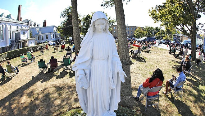 Parishioners take part in an outdoor Mass Sunday at Saint John The Baptist Church in Quincy on Sunday, Oct. 11, 2020.  Greg Derr/ The Patriot Ledger