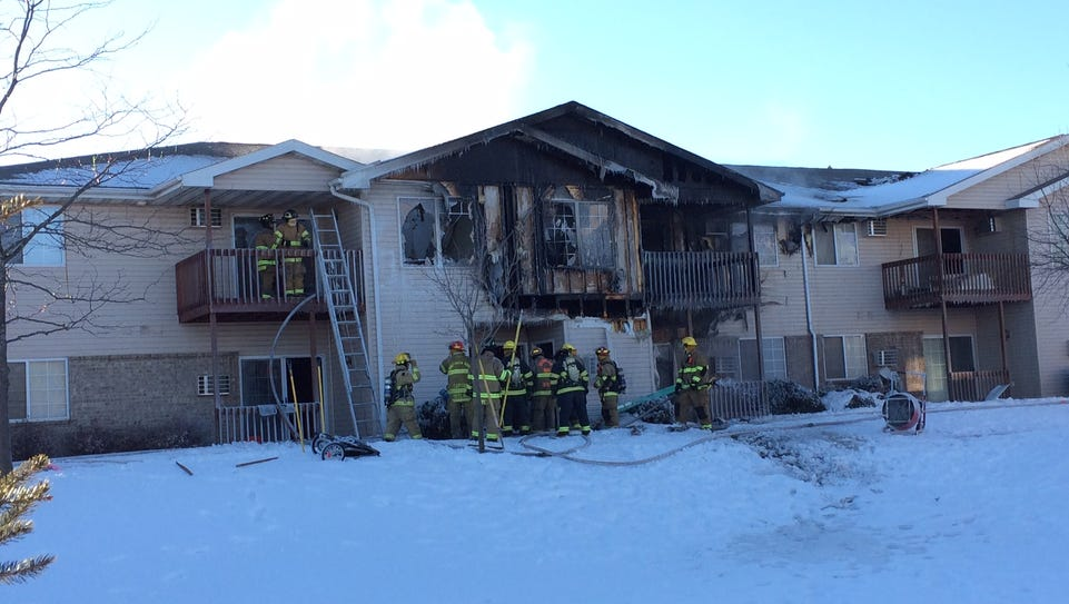 Sturgeon Bay firefighters clean up after a blaze badly
