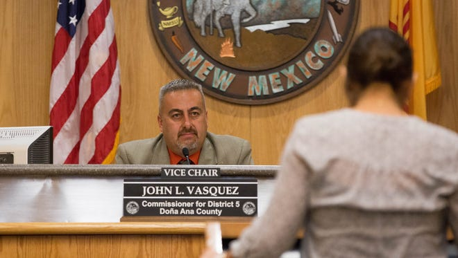 John Vasquez, vice chair and county commissioner for district 5, looks on as Johana Bencomo addresses the Doña Ana County Commission about a recent Facebook exchange between herself and Vasquez, on a now deleted post by Vasquez. Thursday January 25, 2018 at the County Commission meeting.