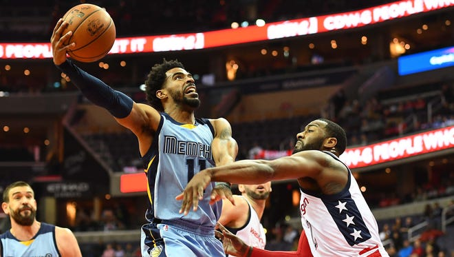 Jan 18, 2017; Washington, DC, USA; Memphis Grizzlies guard Mike Conley (11) shoots over Washington Wizards guard John Wall (2) during the first half at Verizon Center. Mandatory Credit: Brad Mills-USA TODAY Sports
