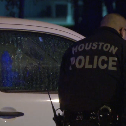 A man was fatally shot while waiting at a traffic light