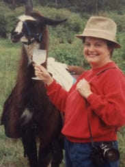 Nancy Marlowe, on assignment, with a llama and a beverage.