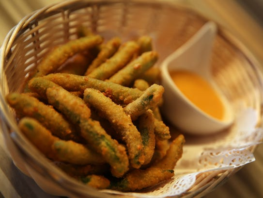 String beans covered in tempura batter and deep fried