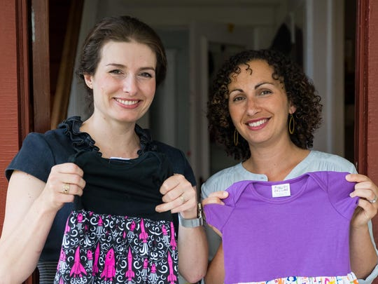 Eva St. Clair, left, and Rebecca Melsky design dresses for Princess Awesome, a girls' clothing line that uses traditional boys' motifs such as trains, dinosaurs, ninjas and planes.