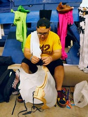 """Tim Schodt prepares a costume for the """"Curtain of Distraction"""" on Feb. 22, 2015 in Tempe."""
