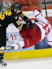 Green Bay Gamblers forward Ryan Smith (15) upends Dubuque Fighting Saints forward Brett Boeing (15) in the first period during Monday night's USHL Eastern Conference semifinal game at the Resch Center in Ashwaubenon.