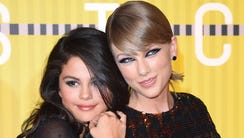 Actress Selena Gomez (L) and musician Taylor Swift
