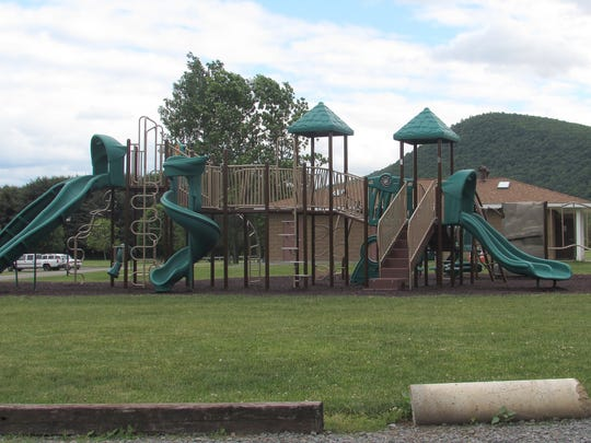 A new playground for young children will be built next to this existing playground in Big Flats.