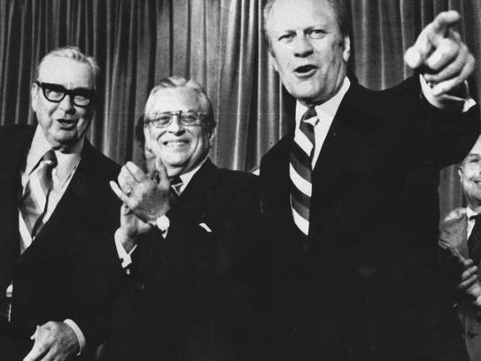 President Gerald Ford points out a friend in the crowd