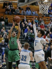 Oshkosh North's Quincy Anderson takes a 3-pointer in the second half of a WIAA sectional game against Eau Claire North.