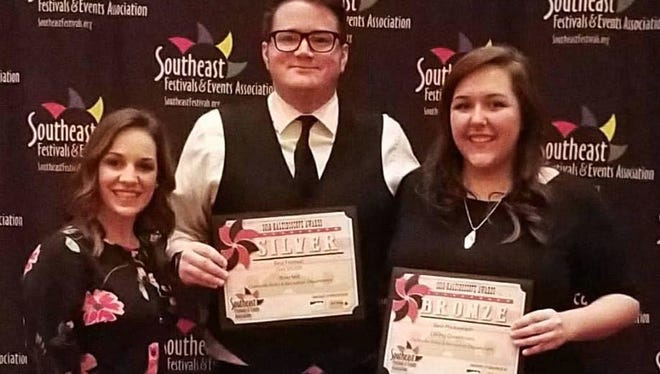 Clarksville Parks & Recreation Department staff members Kara Zahn, Rob Rayburn and Rachel White proudly display the department's two 2018 Kaleidoscope Awards bestowed Monday at the Southeast Events and Festival Association Conference..