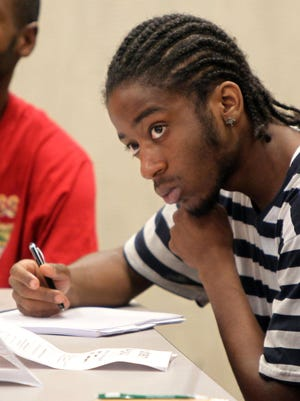 """Deshawn Jones listens and takes notes during the Urban League's SOAR """"Hands Up Initiative"""" class, a three-week job readiness course."""