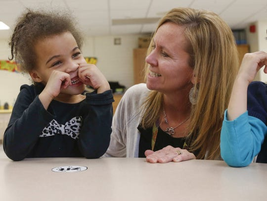 Aaliyah Hunley, 6, works on a project with Theresa