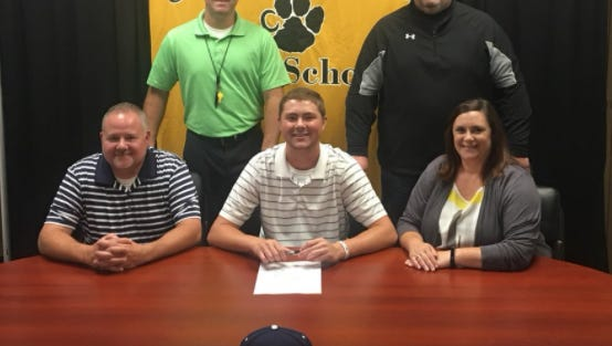 Ty Barbare, center, signs to play baseball next year at Toccoa Falls College.