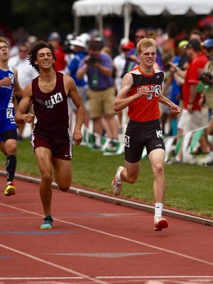Heath's Taylor Hopkins (right) wins the 800 during the Division II state meet Saturday at Jesse Owens Memorial Stadium.