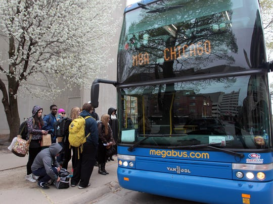 In this file photo from 2013, passengers get into a Megabus on their way to Chicago. The busline in 2015 signed a lease with Coralville and began serving passengers through that city's new Intermodal Facility, but discontinued the service last month. The service is expected to return March 1, 2017.