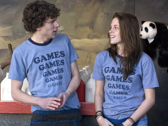"Jesse Eisenberg and Kristen Stewart star as teenagers who fall in love at a summer theme park in ""Adventureland."""