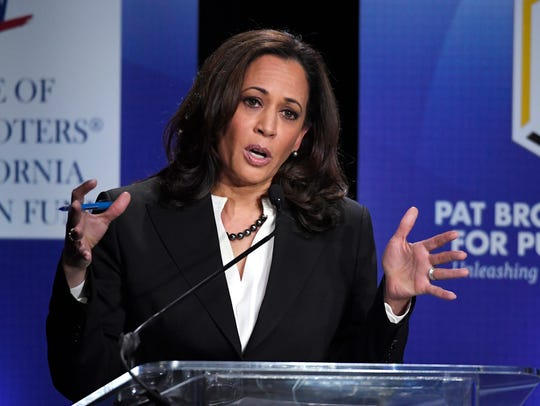Then attorney general for California, Kamala Harris speaks during a debate against Rep. Loretta Sanchez on Oct. 5 in Los Angeles.