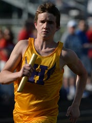 Hagerstown's Alec Hicks begins the 4x800m relay Thursday, May 28, 2015, during the track and field regional in Connersville.