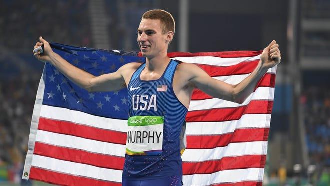 Clayton Murphy celebrates bronze in the 800.