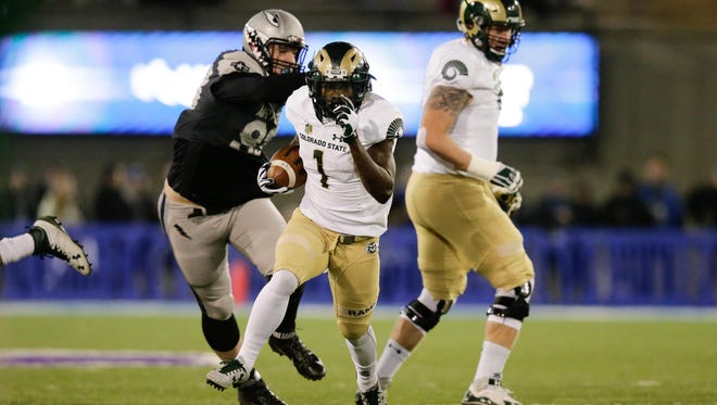 CSU running back Dalyn Dawkins breaks into the open field while running for a 61-yard touchdown in the first quarter of Saturday night's game at Air Force. The Rams had one of their best offensive performances of the season in the 49-46 loss.