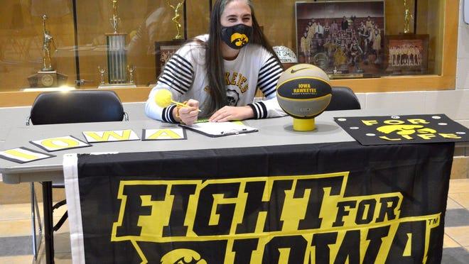 Hamilton's AJ Ediger signed with Iowa for basketball on Wednesday at Hamilton High School.
