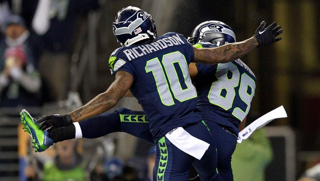 January 10, 2015; Seattle, WA, USA; Seattle Seahawks wide receiver Doug Baldwin (89) celebrates with wide receiver Paul Richardson (10) after he catches a touchdown pass against the Carolina Panthers during the first half in the 2014 NFC Divisional playoff football game at CenturyLink Field.