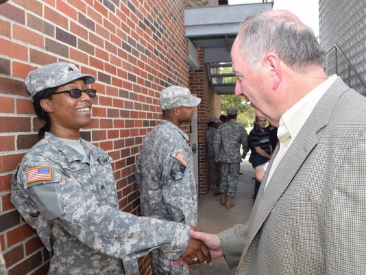 ANI NSU ROTC Natchitoches Mayor Lee Posey talks with NSU ROTC Cadet Danitra Keith after an activation ceremony held for the 66th Demon Battalion. The ceremony marks the beginning of the academic year in which senior Reserve Officer Training Corp (ROTC) ca
