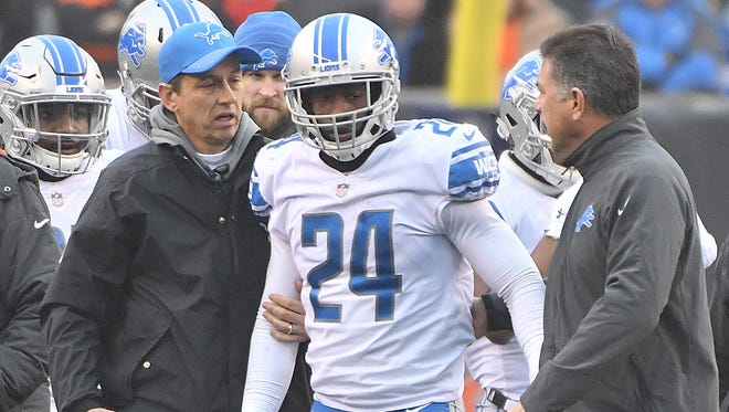 Lions cornerback Nevin Lawson is taken off the field after a hit in the third quarter Sunday in Cincinnati.
