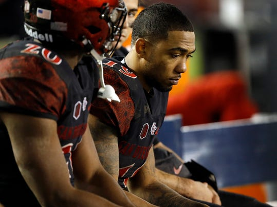 San Diego State running back Donnel Pumphrey, right, and teammates sit on the bench during the second half of an NCAA football game against Colorado State in San Diego, Saturday, Nov. 26, 2016. Pumphrey had 18 carries for 53 yards. Colorado State won 63-31. (AP Photo/Alex Gallardo)