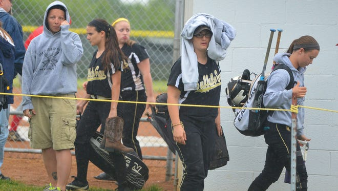 Rain falls as Buffalo Gap's varsity softball team prepares to leave as their Conference 36 championship game against Riverheads High School is postponed in Greenville on Thursday, May 29, 2014.