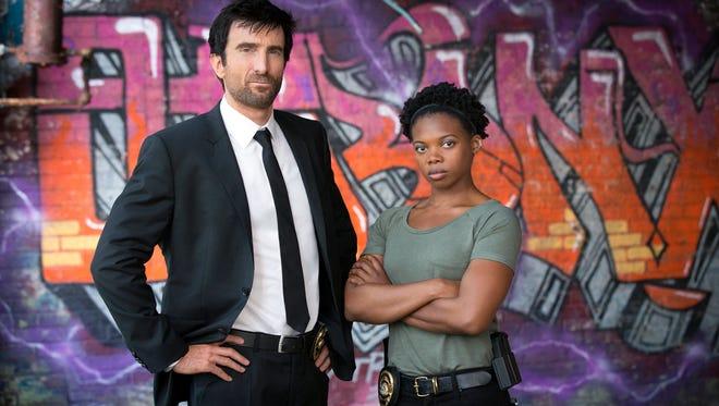 Sharlto Copley stars as Christian Walker and Susan Heyward is Deena Pilgrim in the TV series 'Powers.'