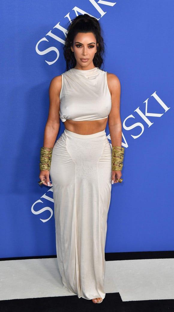 Kim Kardashian West arrived in a two-piece white ensemble