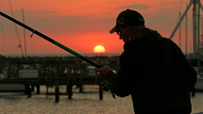 Jim Smith of Milwaukee fishes for northern pike and rainbow trout Oct. 18 off a pier on Lake Michigan. If a pending emergency rule is approved, starting in 2017 sport anglers would have a year-round season and an increased bag limit for lake trout. The season is now closed from Nov. 1 to the end of February.