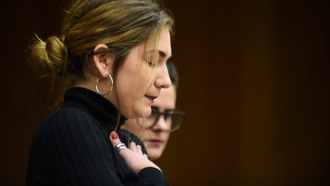Former gymnast Annie Labrie regains her composure Wednesday, Jan. 31, 2018, while giving her victim impact statement during the first day of statements in Eaton County Circuit Court in Charlotte, Mich., where Nassar is expected to be sentenced on three counts of sexual assault some time next week.