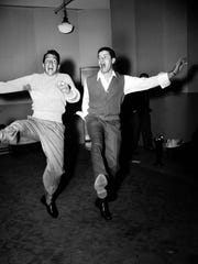 Comedy duo Dean Martin, left, and Jerry Lewis rehearse at the Nola Studios in New York City for their opening at the Copacabana, Jan. 20, 1954.