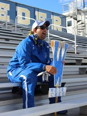 Super Fan Ben Willson has been attending Webster Schroeder and Thomas high school games regularly since 2007, cheering on the teams with his double-sided spirit stick.