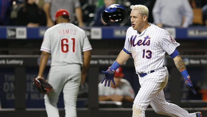 Mets shortstop Asdrubal Cabrera reacts as Philadelphia Phillies relief pitcher Edubray Ramos walks to the dugout after Cabrera hit a three-run, walk-off homer in the 11th inning to give the Mets a 9-8 win Thursday night at Citi Field.
