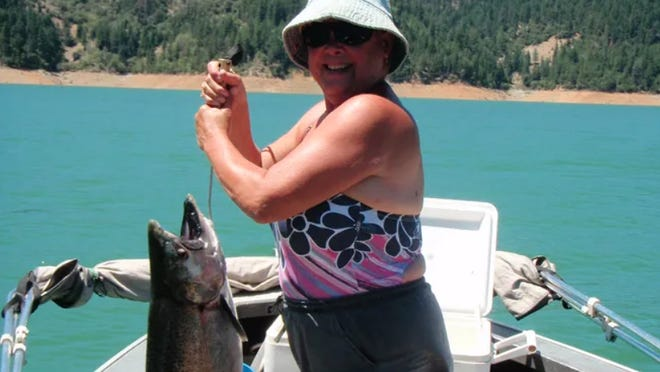 Sally Nachreiner is pictured with her record-breaking king salmon on July 16, 2013, at Trinity Lake. The catch broke the record for the largest king salmony on a sland-locked lake in California history.
