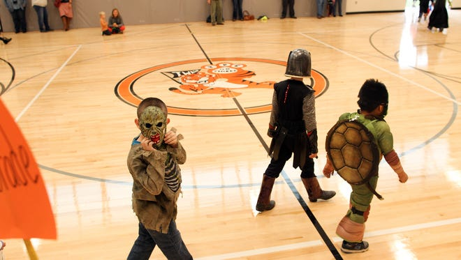Twain Elementary students parade through their new gymnasium in their Halloween costumes on Friday, Oct. 30, 2015.