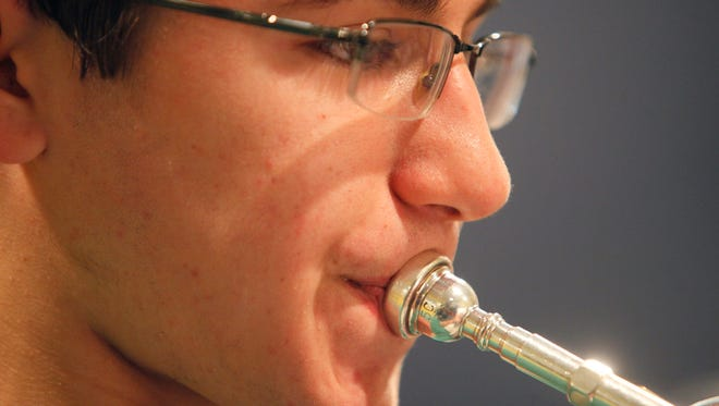 Nicholas Recktenwald, 14, practices his trumpet at home. Recktenwald, of Louisville, was chosen to participate in Carnegie Hall's Weill Music Institute's first National Youth Orchestra 2.