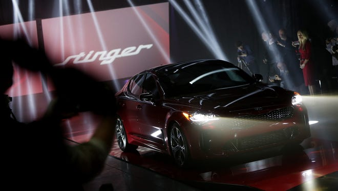 Kia reveals the 2017 Stinger Sedan during the 2017 North American International Auto Show at the Russell Industrial Center in Detroit on Sunday, Jan. 8, 2017.