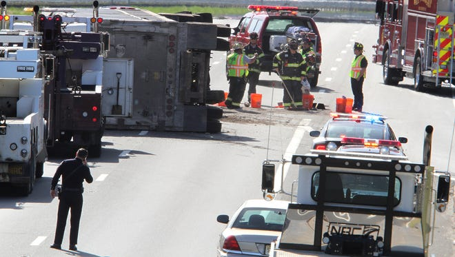 An overturned truck on Route 195 in Wall Township, just past the Route 34 overpass, closed all westbound lanes and spilled traffic onto Route 34 and the Parkway in the area Tuesday afternoon, April 18, 2017.