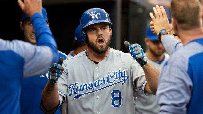 Jun 28, 2017; Detroit, MI, USA; Royals third baseman Mike Moustakas is congratulated by teammates after he hits a home run in the fourth inning against the Tigers at Comerica Park.